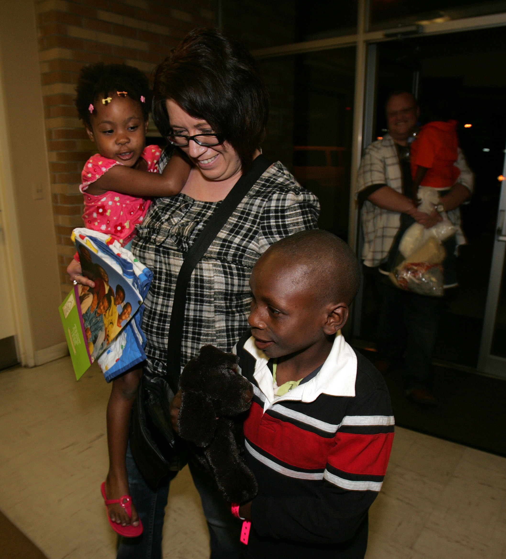 David and Candice Aitken reunite with Fabrice, 8, their third adopted son from Haiti, Tuesday night at His House Children's Home in Opa-Locka, Florida.